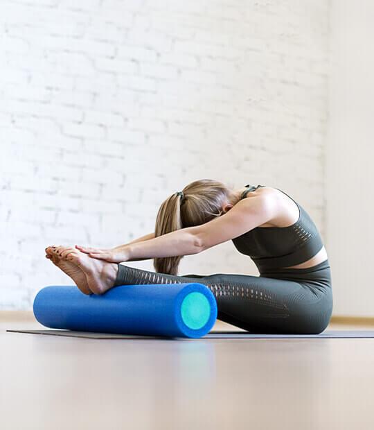 Woman in folded yoga pose.