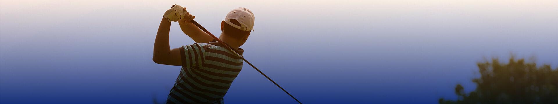 Man golfing.