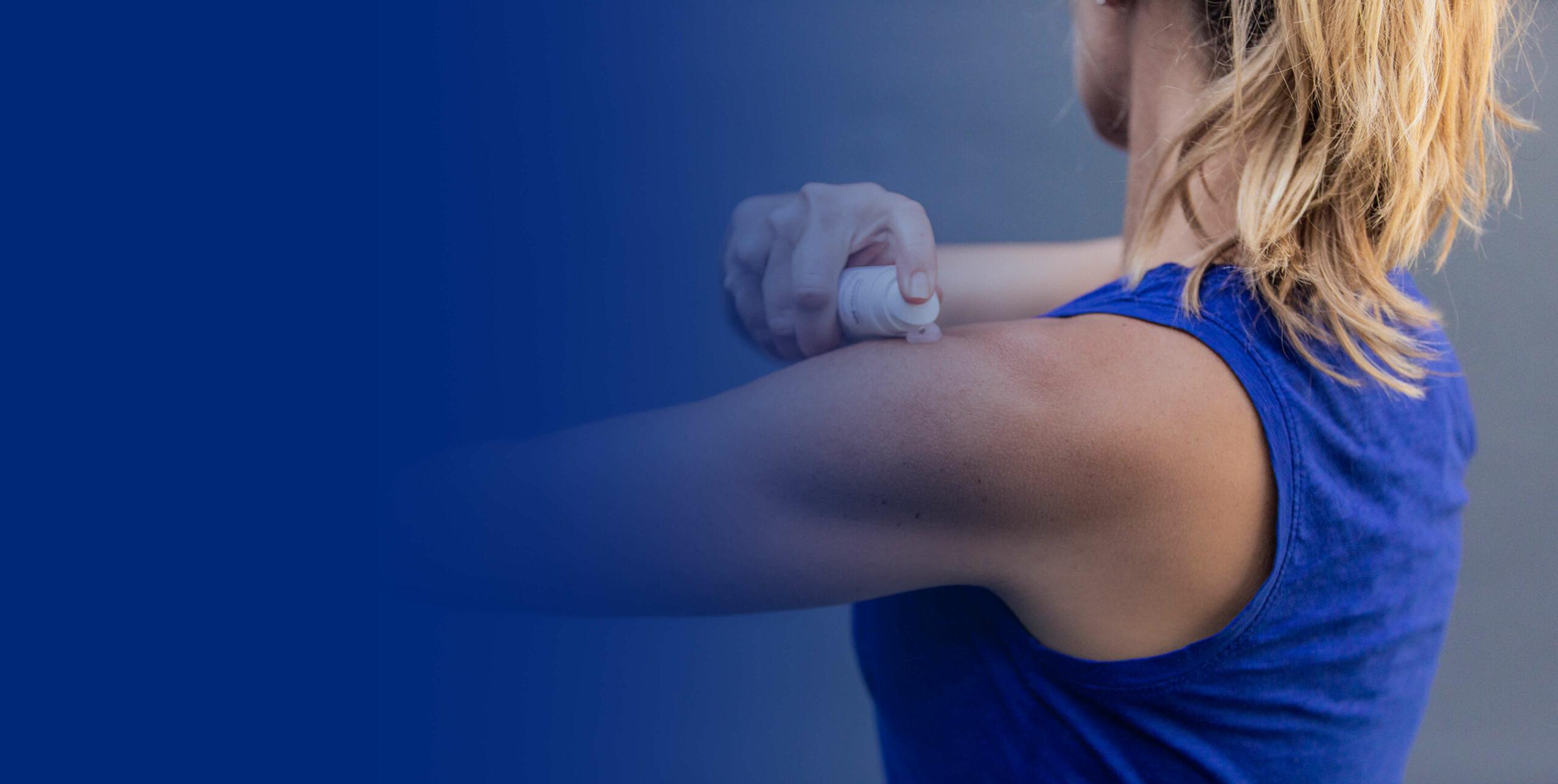 Athlete applying Phytozol on shoulder